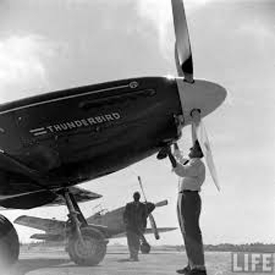 "April 1949, Joe DeBona polishes ""Thunderbird,"" with Paul Mantz and his P-51C NX1204, ""Latin American"" in the background. (Allan Grant/LIFE Magazine)"