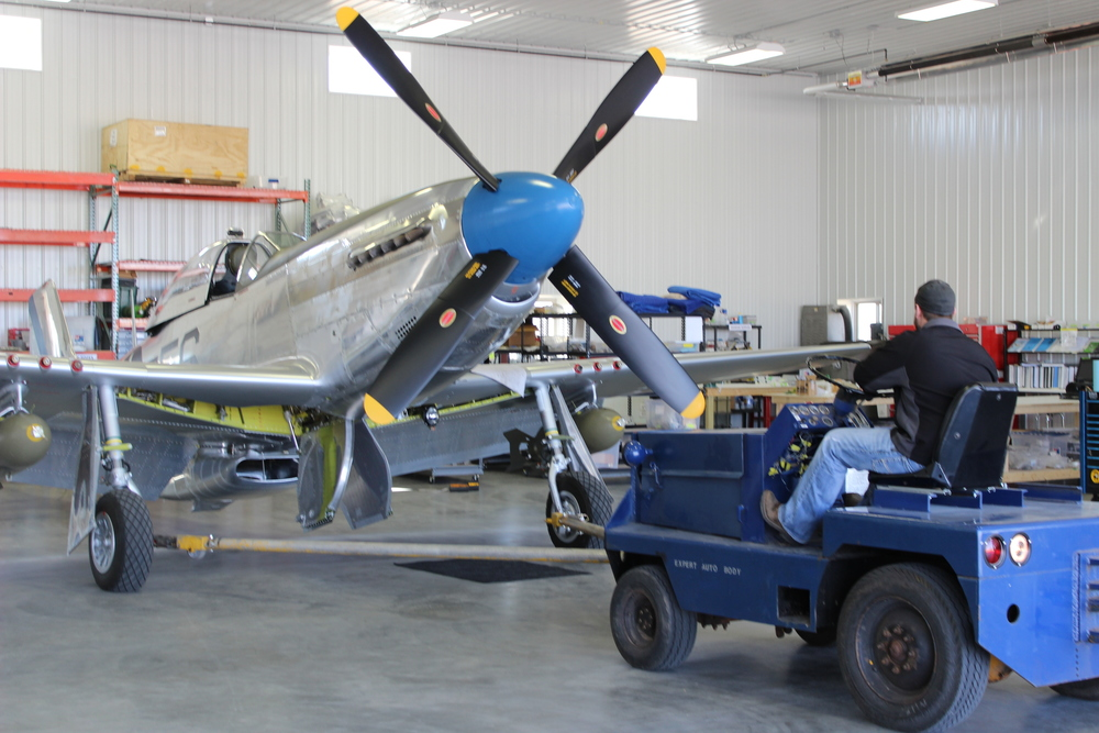 Towing Sierra Sue II out of the hangar