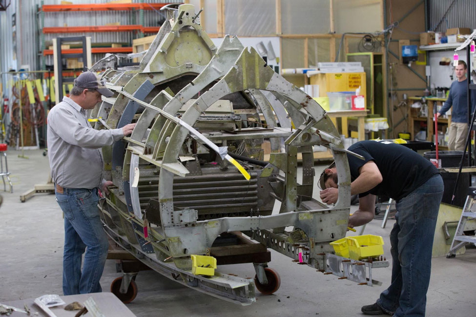 Robb and Randy continue work on fuselage disassembly.