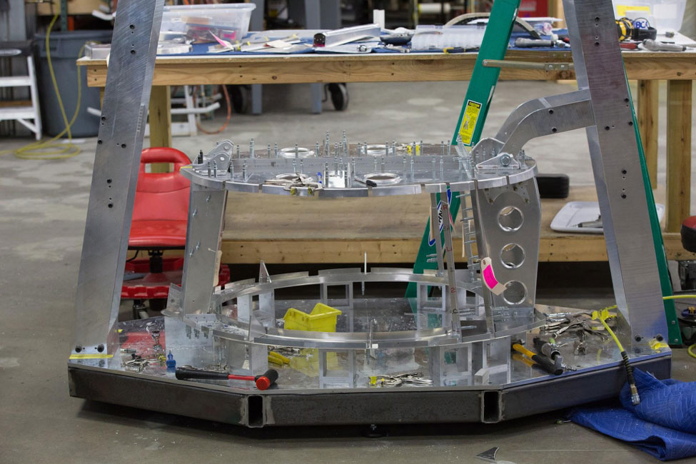 As tail cone assembly begins, the forward frames are attached to the fixture.