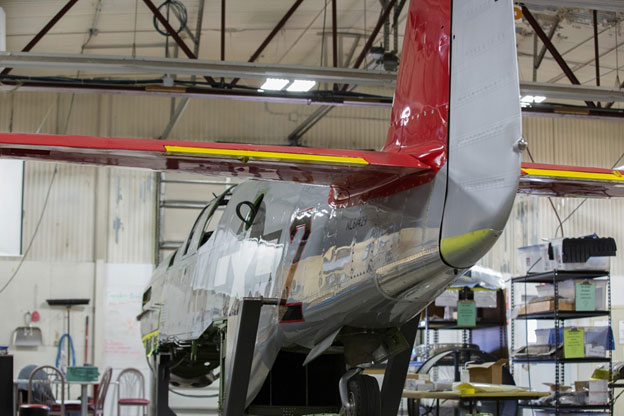 Rear view shows the red horizontal and vertical stabilizers, the rudder will become red when the entire Mustang is repainted.
