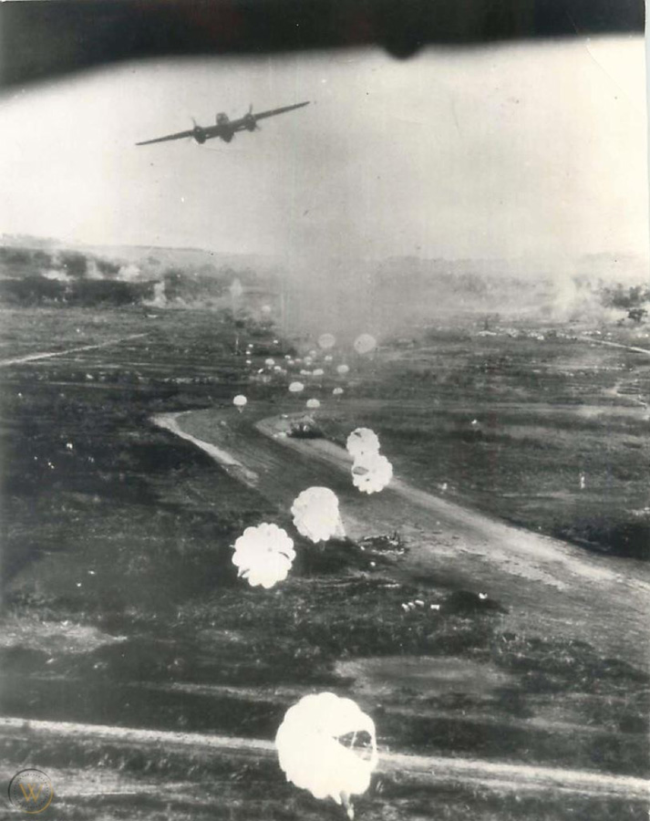 A 345th bomb group, 499th Bomb Squadron B-25 lays a string of 23 pound parafrag bombs on Clark Field in the Philippines. USAAF photo.