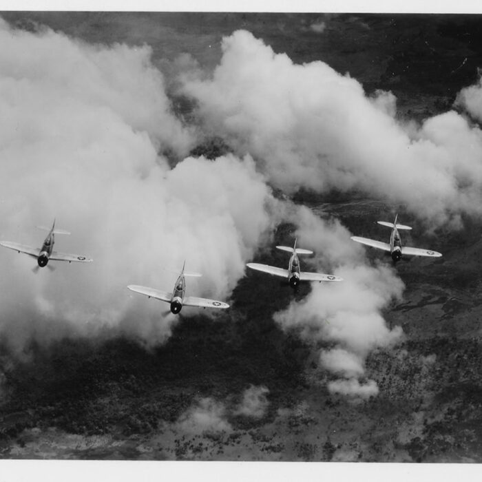 39th Fighter Squadron P-47s fly over Papua New Guinea