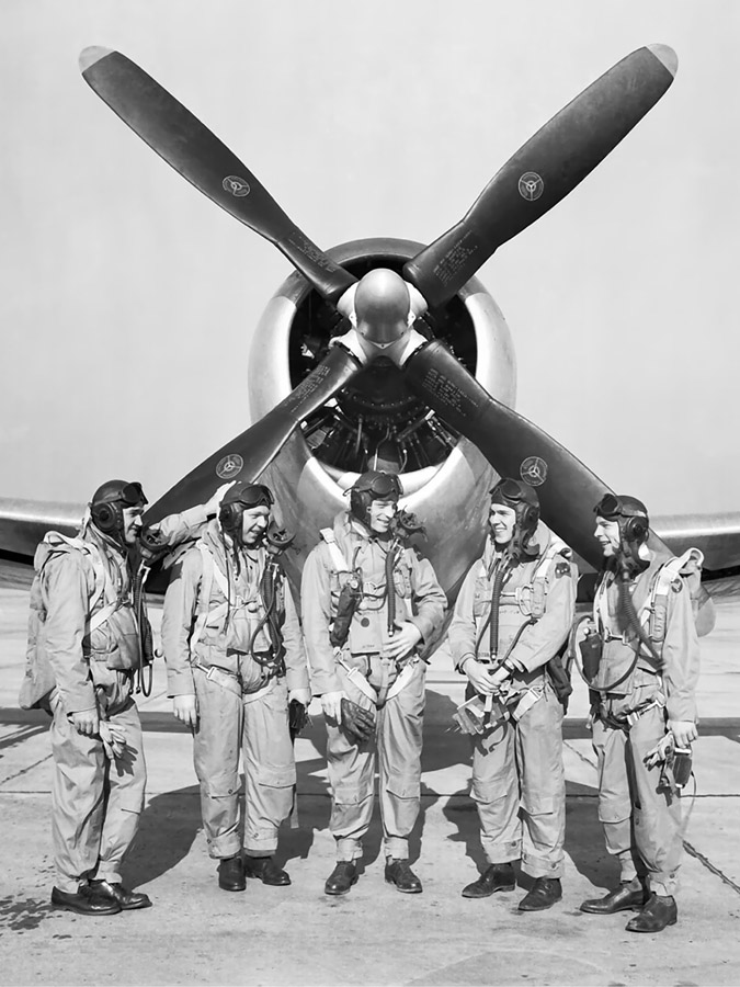Test pilots in front of a P-47 with a Curtiss Electric prop like P-47D-23RA 42-27609 had.