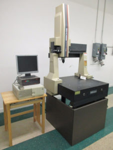 An example of an early CMM. Note the permanent setup and its scanning limitations due to dimensions of the table area.