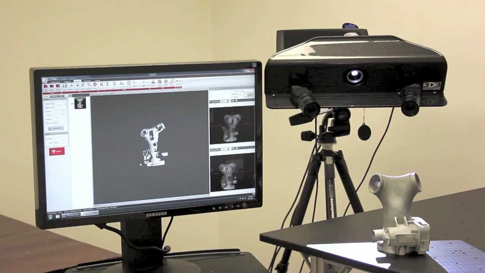"""HDI manufacturers a structured """"white light"""" type scanner. Note the projector, centered in the unit, that emits the structured light."""