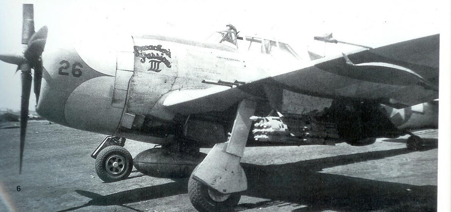 Preacher's Passion III, 39th Fighter Squadron, with 75 gallon centerline drop tank and cluster bombs.