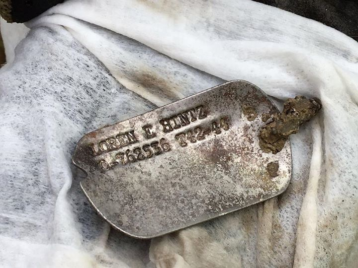 Loren Hintz's recovered dog tag (photo credit: Archeologi dell'Aria)