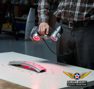 Stefan using our portable 3D scanner for reverse engineering a P-51 cowl former.
